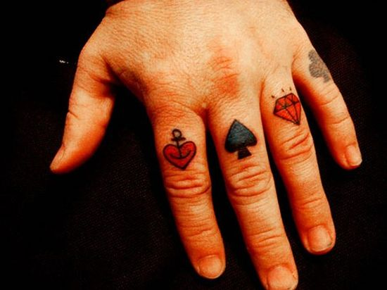 card suits are always a hit for them. This simple red and black tattoo